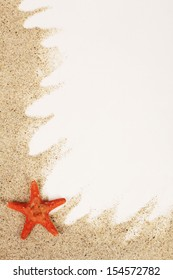 Red starfish on sand from sea - vertical