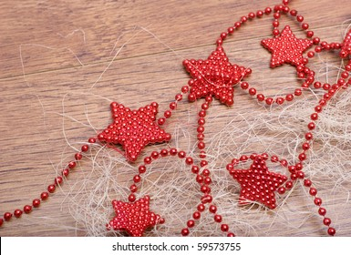 Red stars on a wooden floor.