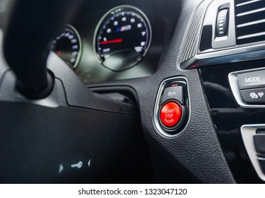 Red start-stop button in a car