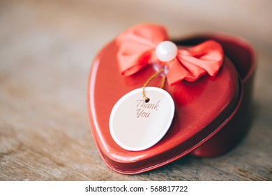 Red steel heart box on wooden background with selective focus, valentines day or love concept and best for wedding invitation, processed vintage style