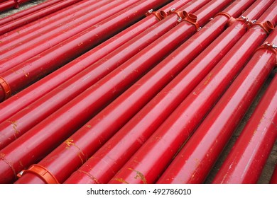 red steel pipes overlap on the floor.
