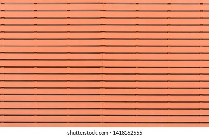 Red steel structure of the battens wall