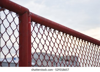 Red Steel wall Mesh on sky background