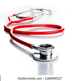 red stethoscope on white background