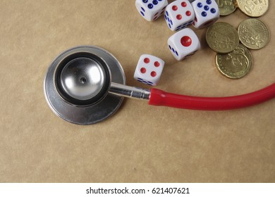 Red stethoscope on wooden background. Medical and health care concept.