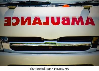 Red sticker on ambulance car ( reverse alphabet )