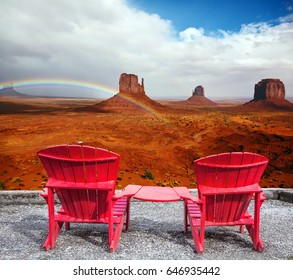 """Red stone desert Navajo, USA. Isolated rocks - """"mitts"""" intersect with the beautiful rainbow."""