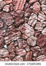 Red stone mosaic wall for decorative ornament background
