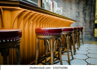 Red stool chairs and Drinking establishment. Interior of pub, cafe or bar.Counter bar.Vintage stool chairs.