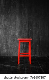 The red stool in a dark room