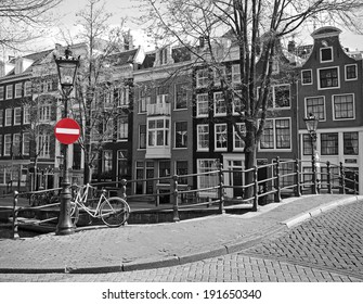 red stop on black and white cityscape of Amsterdam
