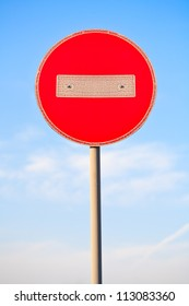 Red stop road sign and blue sky.