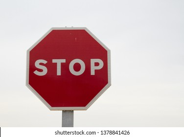 Red stop sign, isolated Traffic regulation warning sign Octagon, octagonal frame white, metal post on white background