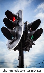 Red stop signal for cars and green pedestrian light on urban traffic light