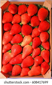 Red strawberries in box