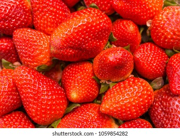 Red strawberries in a market, fresh fruits