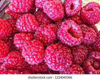 Red strawberries on a wooden table, close up