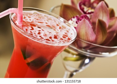 Red strawberry cocktail over blurry background