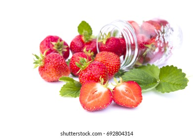 red strawberry with green leafin the glass on white background