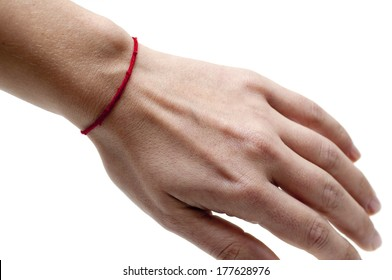 Red string bracelet on a woman's' left hand, to ward off misfortune.