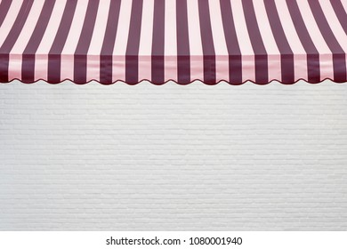 Red stripes awning with white brick wall background