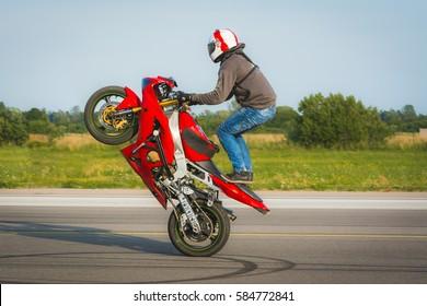Red stunt bike wheelie