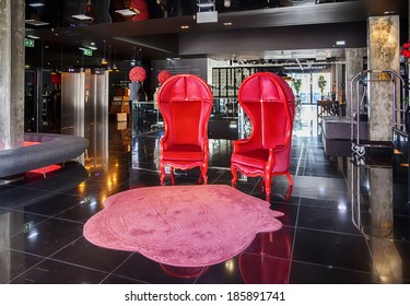 red stylish chair in hotel lobby