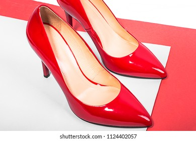 Red stylish women shoes. High heels. White background.