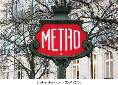 Red subway sign in the center of Paris, France