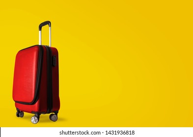 Red suitcase on yellow wall, holiday background
