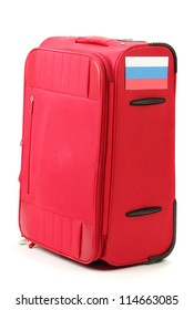 red suitcase with sticker with flag of Russian Federation isolated on white