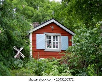 Red summer garden shed in Sweeden