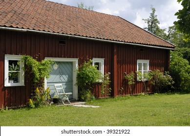 Red summer house. The red color with white framing common in Sweden.