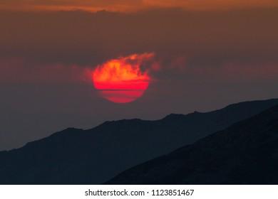 red sun clowds