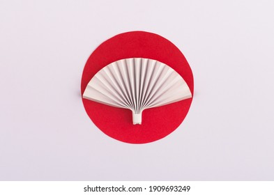 Red sun and origami paper fan isolated on white background. Paper design for Japan National Foundation day.