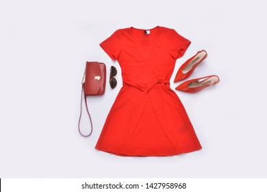 Red sundress and high hell shoes and sunglasses,leather handbag on white background