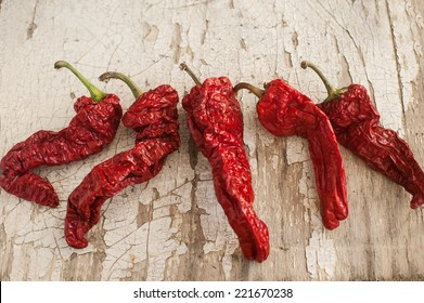 Red Sun-Dried Chili Pepper on Wooden Table.