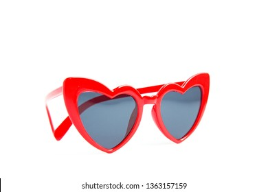 Red sunglasses heart shape isolated on white background