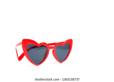 Red sunglasses heart shape on white background. Copy space