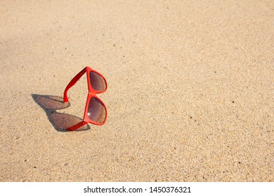 Red sunglasses on the beach, Thailand