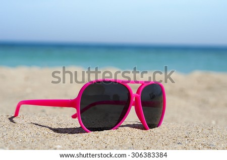 00bc3714e602 Red Sunglasses On Sandy Beach Stock Photo (Edit Now) 306383384 ...