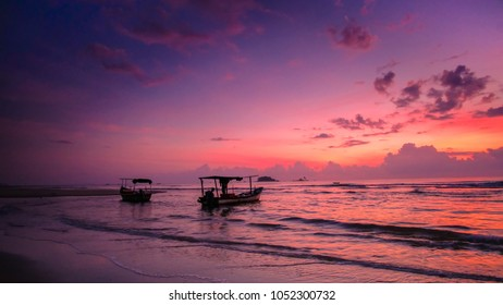 Red Sunrise With Fisherman Boat At Cherating Beach Pahang Malaysia