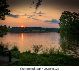 Red sunrise over Jacobson Park Lake in Lexington, KY - Shutterstock ID 2008548125