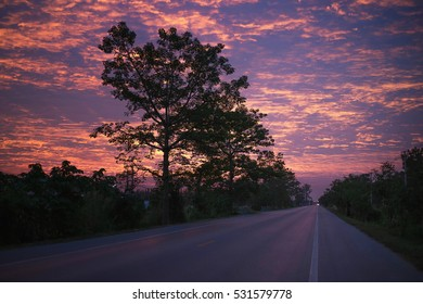 red sunrise over road.