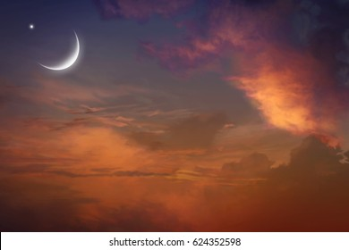 Red sunset and moon .  Mubarak background  .  Against the background of clouds . beautiful sky. Yellow and pink clouds . Sunset and new moon Prayer time