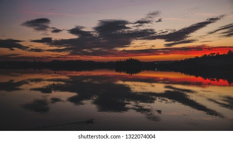 Red sunset on Lake Pusiano in Lombardy (Italy)