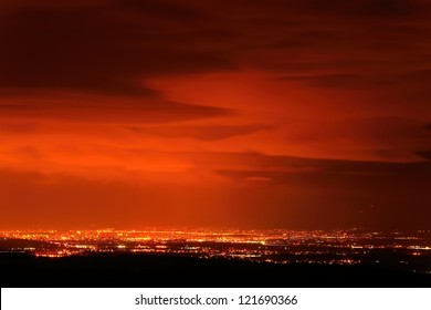 Red sunset over the city covered by clouds over Sofia, Bulgaria