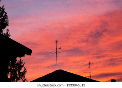 Red sunset over the rooftops, horizontal image