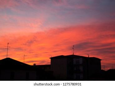 Red sunset over the town, horizontal image
