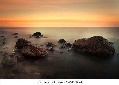 Red sunset with water nebula on the Baltic Sea